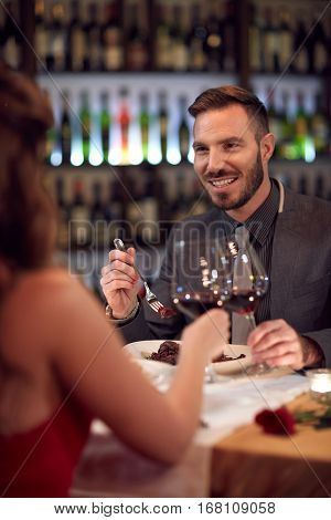 Handsome man at dinner with elegance lady