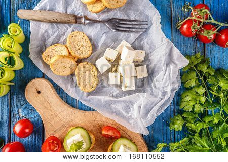 Feta cheese cube and bread rusks fine toasted