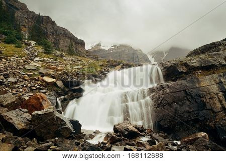 Yoho national park view with mountains, waterfall and forest in Canada.