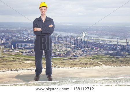 Giant young worker with steel factory on background