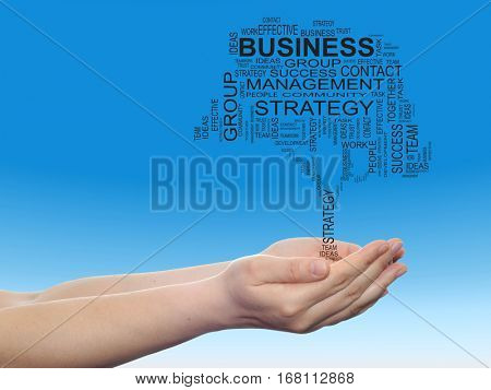 Concept conceptual business text word cloud on man hand tagcloud on blue sky background metaphor to business, team, teamwork, management, effective, success, communication, company, cooperation symbol