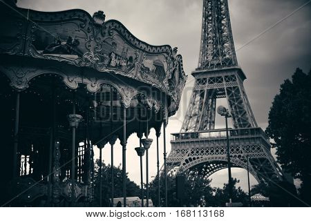 PARIS, FRANCE - MAY 13: Carrousel and Eiffel Tower on May 13, 2015 in Paris. With the population of 2M, Paris is the capital and most-populous city of France