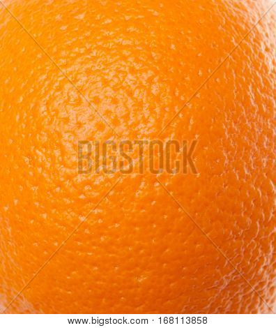 the texture of the orange peel the orange with a rough surface