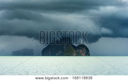 Island in the storm. Cyclone Sea. Storm on the horizon