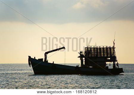 Cargo Ship. Silhouette of cargo ship. The silhouette of the ship