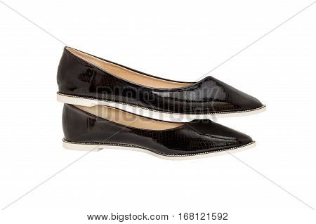A pair of black patent leather female shoes isolated on white.