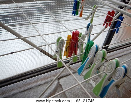 Colorful Plastic Clothes Pegs On Lines
