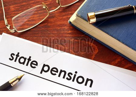 Paper with title state pension on a table.
