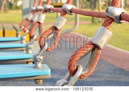 Perspective of rope tied in the playground,use a symbol for strength, tolerance, endeavor concept,construction equipment.