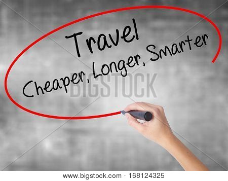Woman Hand Writing Travel Cheaper Longer Smarter  With Black Marker Over Transparent Board
