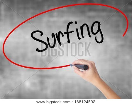 Woman Hand Writing Surfing  With Black Marker Over Transparent Board