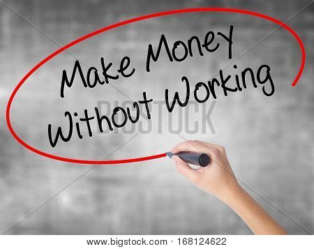 Woman Hand Writing Make Money Without Working With Black Marker Over Transparent Board
