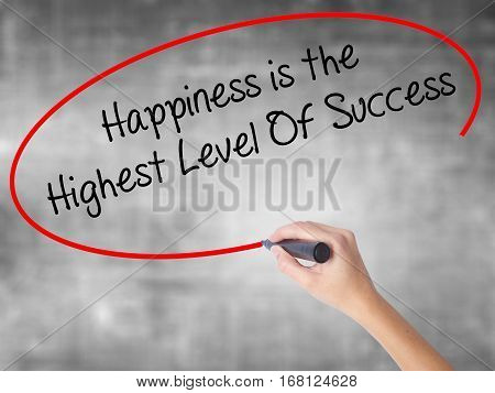 Woman Hand Writing Happiness Is The Highest Level Of Success With Black Marker Over Transparent Boar
