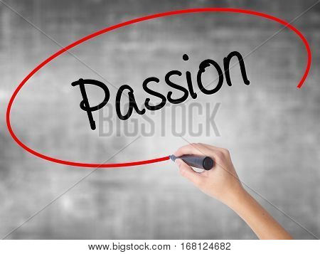 Woman Hand Writing Passion With Black Marker Over Transparent Board