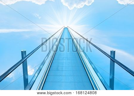 Stairway to heaven with blue sky clouds and god sun light. Religion concept