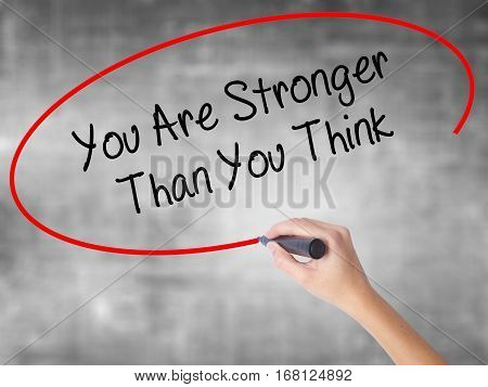 Woman Hand Writing You Are Stronger Than You Think With Black Marker Over Transparent Board