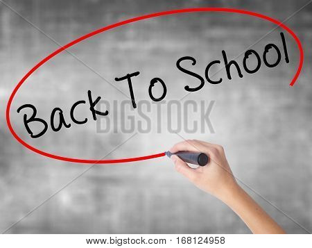 Woman Hand Writing Back To School With Black Marker Over Transparent Board