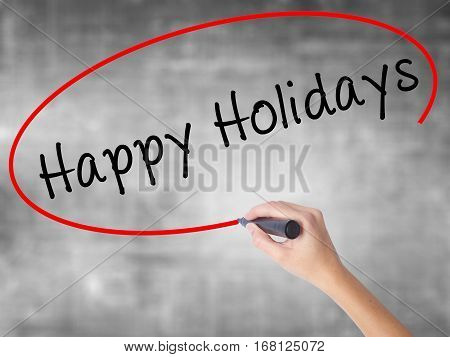 Woman Hand Writing Happy Holidays With Black Marker Over Transparent Board