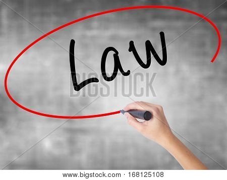Woman Hand Writing Law With Black Marker Over Transparent Board