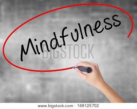 Woman Hand Writing Mindfulness  With Black Marker Over Transparent Board