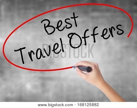 Woman Hand Writing Best Travel Offers  With Black Marker Over Transparent Board