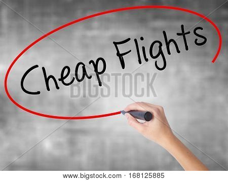Woman Hand Writing Cheap Flights With Black Marker Over Transparent Board