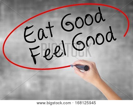 Woman Hand Writing Eat Good Feel Good With Black Marker Over Transparent Board