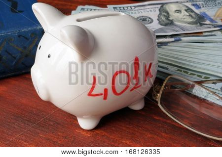 White piggy bank with red sign 401k.