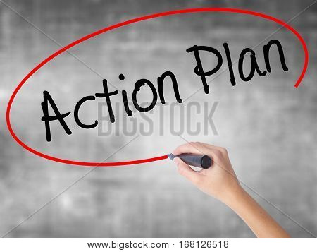 Woman Hand Writing Action Plan With Black Marker Over Transparent Board