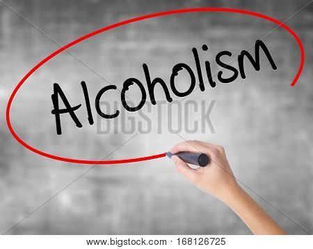 Woman Hand Writing Alcoholism With Black Marker Over Transparent Board.