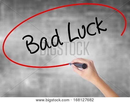 Woman Hand Writing Bad Luck With Black Marker Over Transparent Board