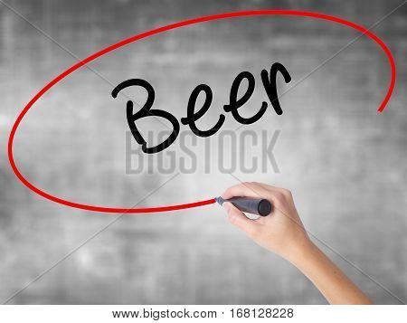Woman Hand Writing Beer With Black Marker Over Transparent Board