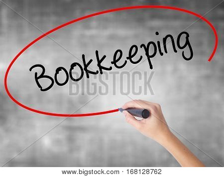 Woman Hand Writing Bookkeeping With Black Marker Over Transparent Board.