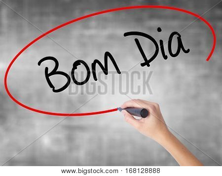 "Woman Hand Writing ""bom Dia"" (in Portuguese - Good Morning)  With Black Marker Over Transp"