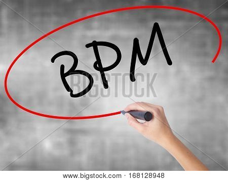 Woman Hand Writing  Bpm (business Process Management) With Black Marker Over Transparent Board