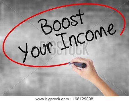 Woman Hand Writing Boost Your Income With Black Marker Over Transparent Board