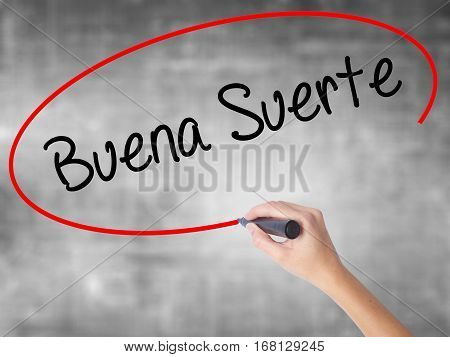 Woman Hand Writing Buena Suerte( Good Luck In Spanish) With Black Marker Over Transparent Board
