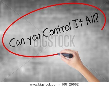 Woman Hand Writing   Can You Control It All? With Black Marker Over Transparent Board