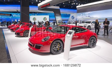 DETROIT MI/USA - JANUARY 12 2015: Porsche 911 Carrera 4 GTS Boxster GTS Cayman GTS Panamera GTS cars at the North American International Auto Show (NAIAS) one of the most influential car shows in the world each year.