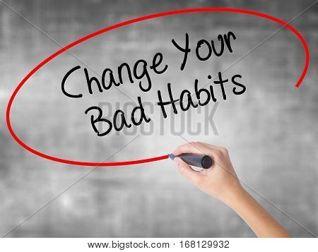 Woman Hand Writing Change Your Bad Habits  With Black Marker Over Transparent Board