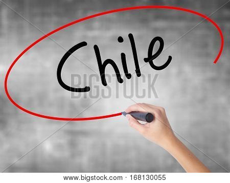Woman Hand Writing Chile  With Black Marker Over Transparent Board