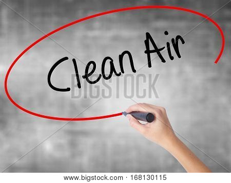 Woman Hand Writing Clean Air With Black Marker Over Transparent Board
