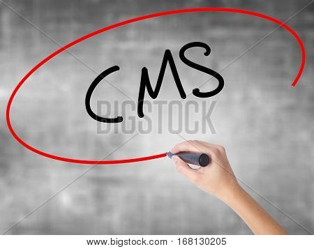 Woman Hand Writing Cms (custom Management System) With Black Marker Over Transparent Board