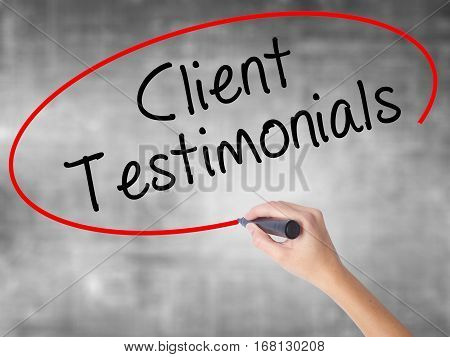 Woman Hand Writing Client Testimonials With Black Marker Over Transparent Board