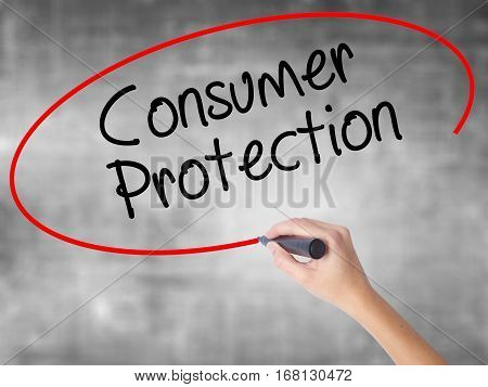 Woman Hand Writing Consumer Protection With Black Marker Over Transparent Board.