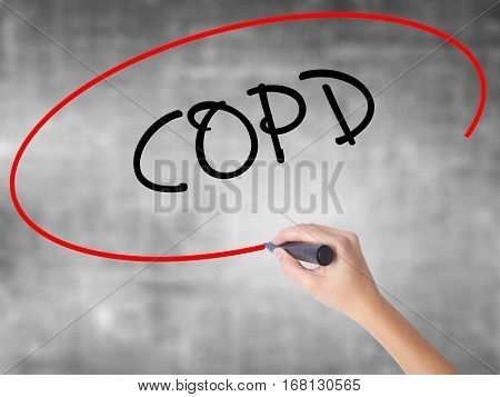 Woman Hand Writing Copd With Black Marker Over Transparent Board