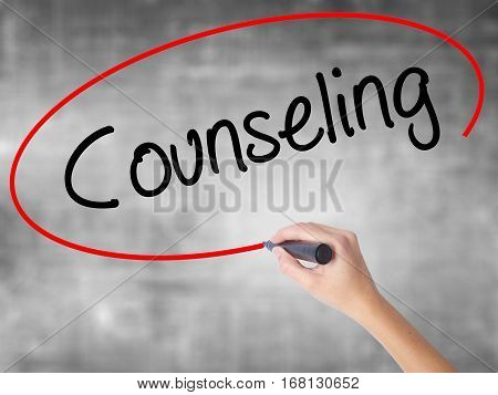 Woman Hand Writing Counseling With Black Marker Over Transparent Board