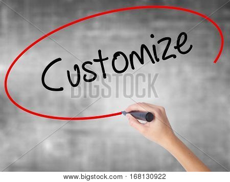 Woman Hand Writing  Customize With Black Marker Over Transparent Board