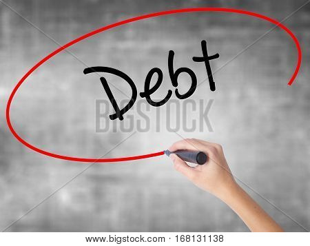 Woman Hand Writing Debt With Black Marker Over Transparent Board