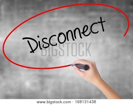 Woman Hand Writing Disconnect With Black Marker Over Transparent Board